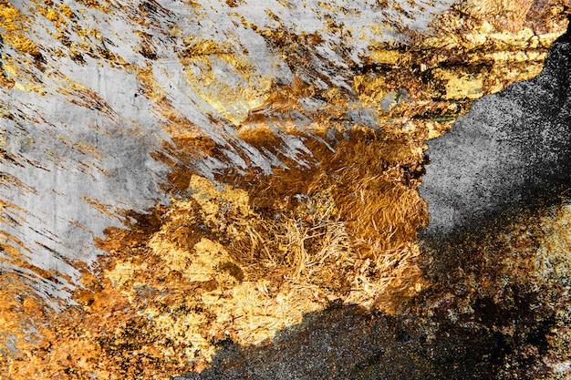 Goud op beton Gratis Foto