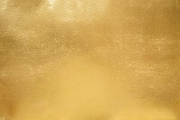 Gouden achtergrond of textuur en gradiënsschaduw. Premium Foto
