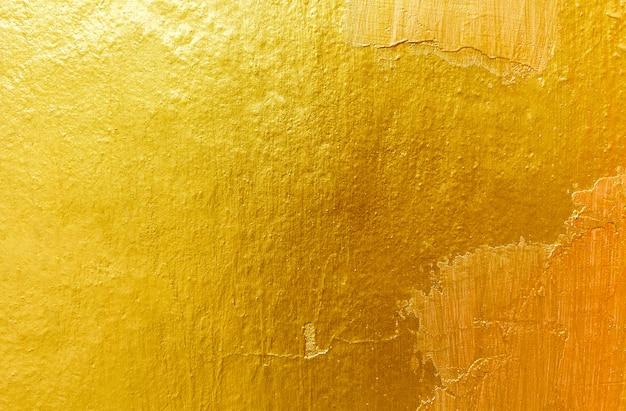Gouden achtergrond of textuur en gradiëntenschaduw. Premium Foto