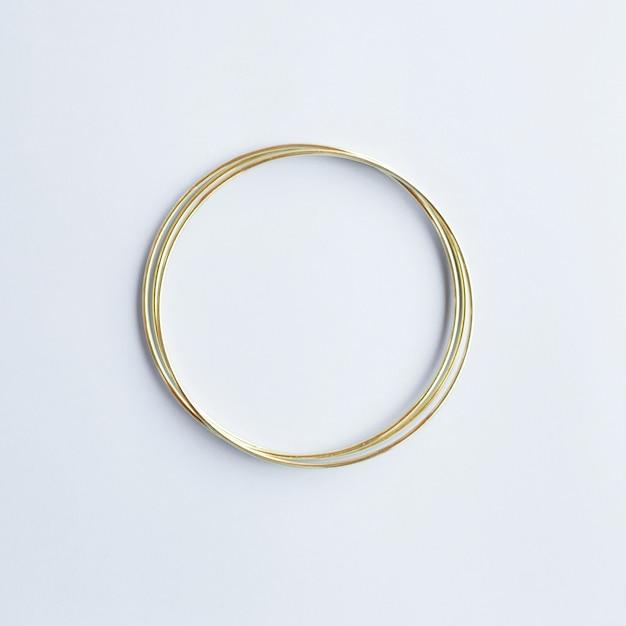 Gouden cirkel met copyspace Gratis Foto