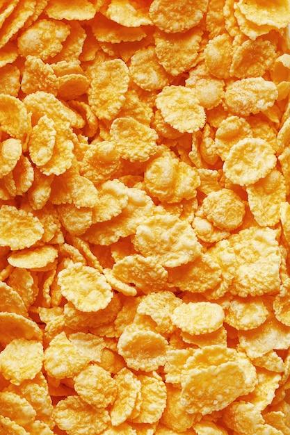 Gouden cornflakes, bovenaanzicht, gezond ontbijt Premium Foto
