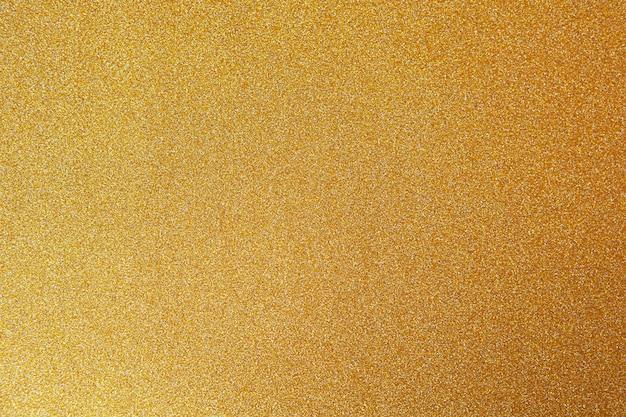 Gouden feestelijke achtergrond, close-up. Premium Foto
