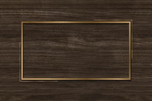 Gouden frame op een bruine achtergrond Gratis Foto