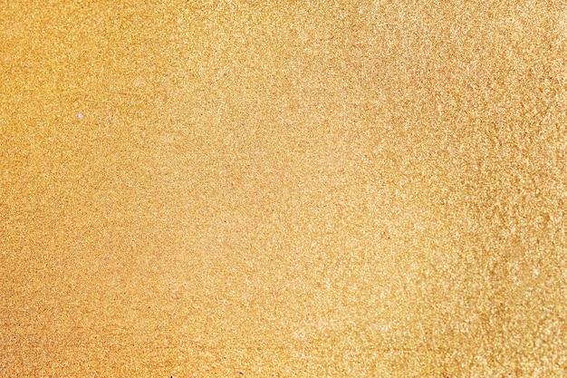 Gouden gestructureerde achtergrond Gratis Foto