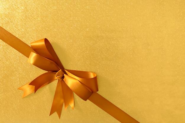 Gouden gift boog achtergrond Gratis Foto