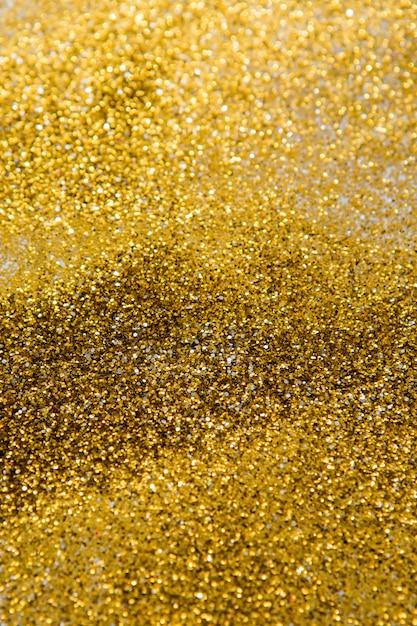 Gouden glitter achtergrond, bokeh Premium Foto