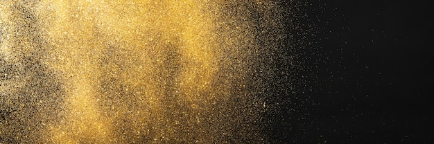 Gouden glitter op zwarte achtergrond Premium Foto