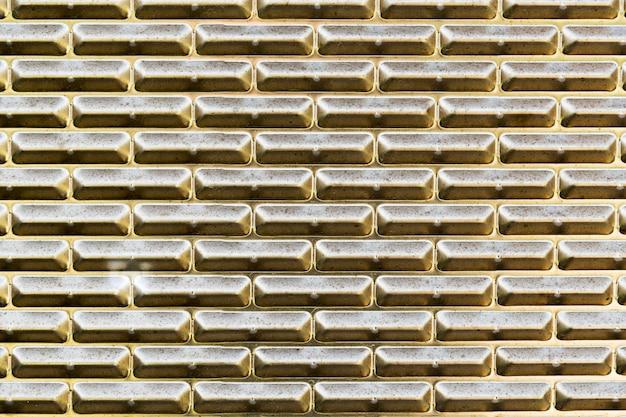 Gouden metalen textuur buitenshuis muur Premium Foto