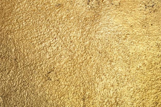 Gouden muurachtergrond Gratis Foto