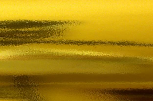 Gouden papier textuur. abstracte gouden folie metalen achtergrond. Premium Foto