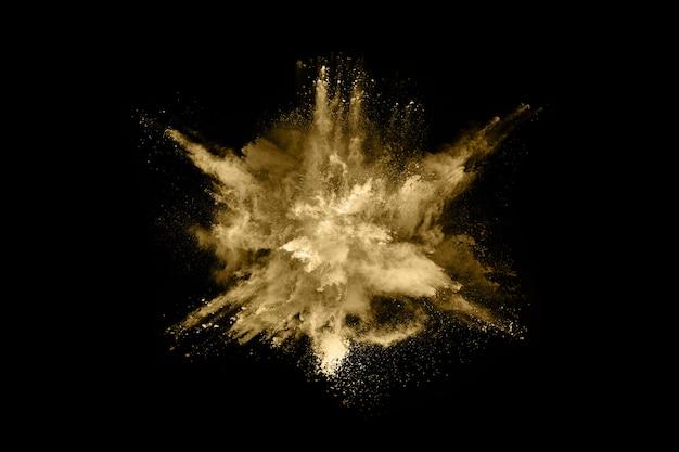 Gouden poeder explosie op zwarte achtergrond Premium Foto
