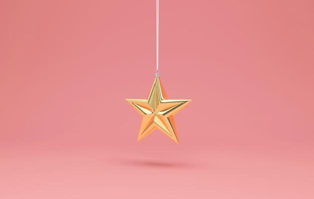 Gouden ster speelgoed opknoping op roze studio achtergrond Premium Foto
