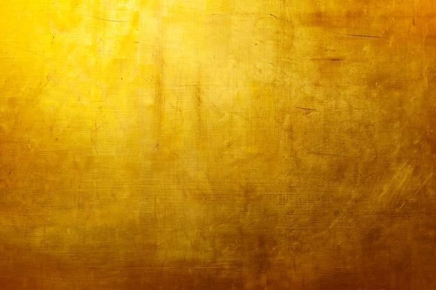 Gouden textuurbehang Gratis Foto
