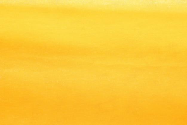 Gouden van de stoffendoek textuur als achtergrond Premium Foto