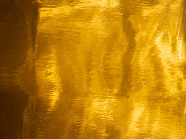 Gouden verzadigde textuurachtergrond Gratis Foto