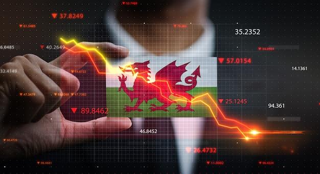 Grafiek vallen voor wales vlag. crisis concept Premium Foto
