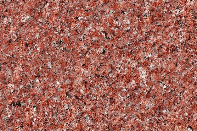 Graniet achtergrond. natuursteentextuur. rood oppervlak. patroon. Premium Foto