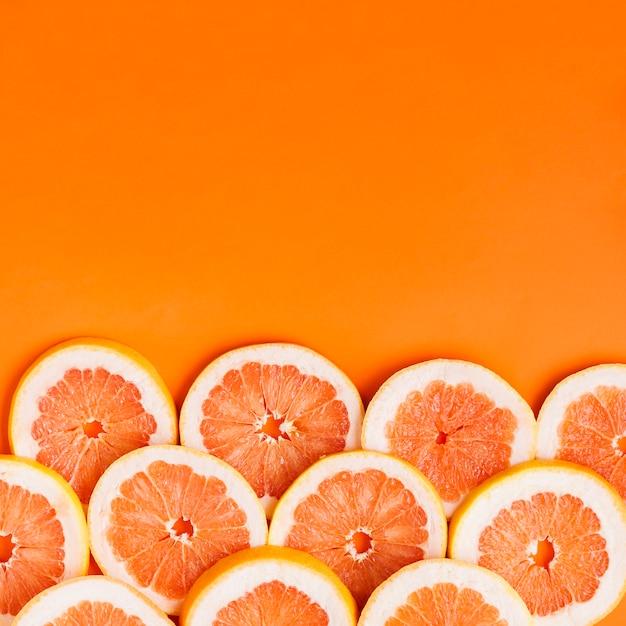 Grapefruitachtergrond met copyspace Gratis Foto