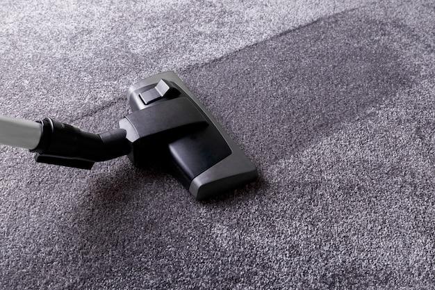Grijs tapijt en schoner Premium Foto