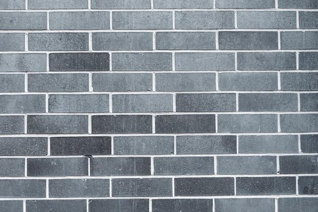 Grijze bakstenen muurachtergrond Premium Foto