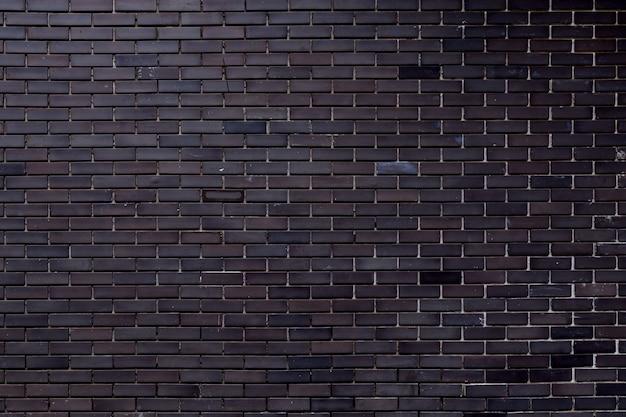 Grijze bakstenen muurtextuur met vuil van bouw die voor achtergrond gebruiken. Premium Foto