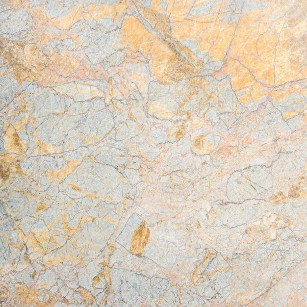 Grijze marmeren stenen muur of vloer textuur achtergrond Premium Foto