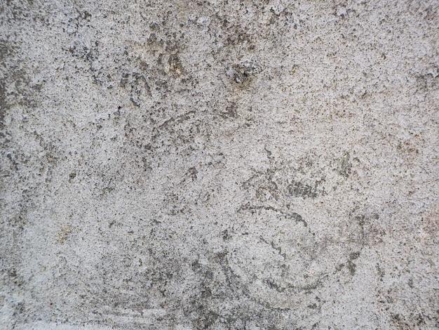 Grijze muur achtergrond gemaakt van cement Gratis Foto
