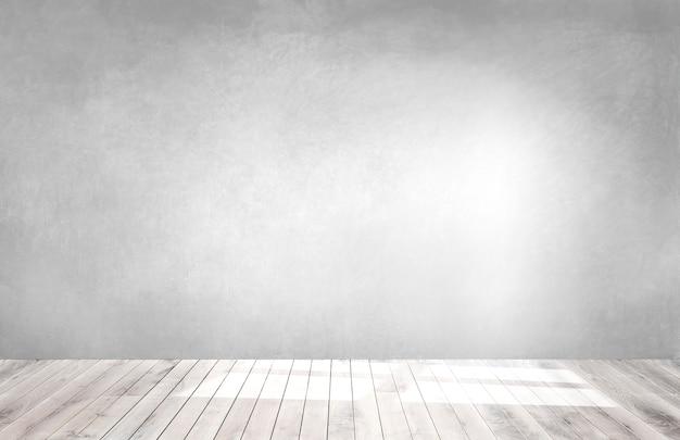 Grijze muur in een lege ruimte met een houten vloer Gratis Foto