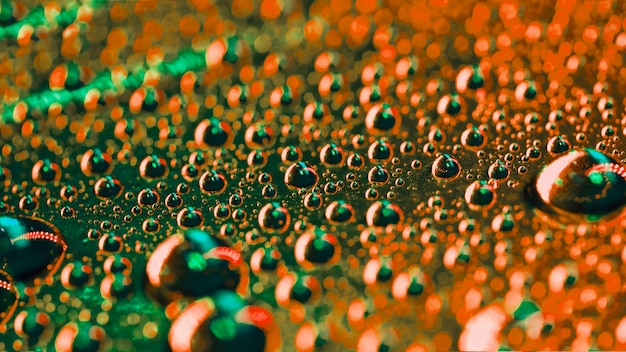 Groen en een oranje water bubbels detail achtergrond Gratis Foto