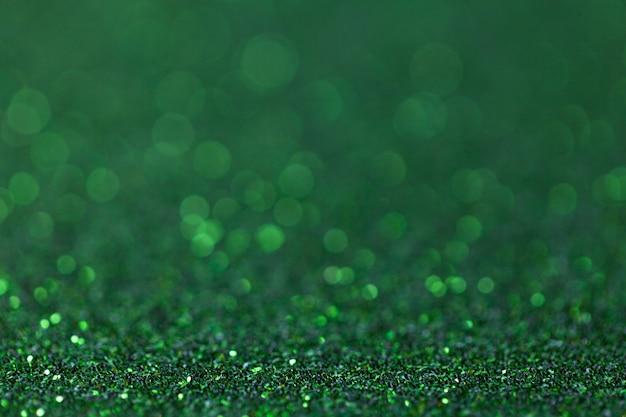 Groene fonkelende achtergrond van kleine lovertjes, close-up. schitterende achtergrond Premium Foto