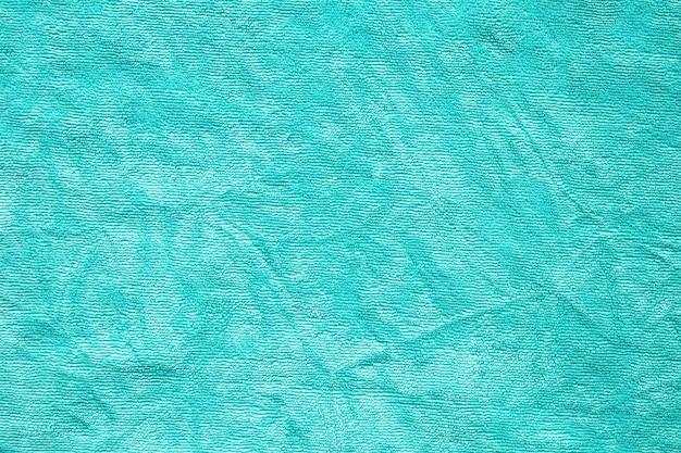 Groene handdoek stof textuur oppervlak close-up achtergrond Premium Foto