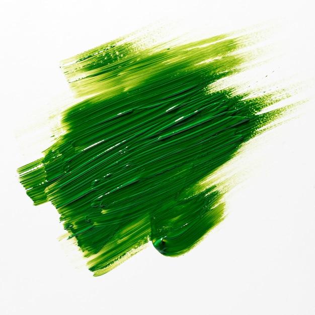 Groene penseelstreek op witte achtergrond Gratis Foto