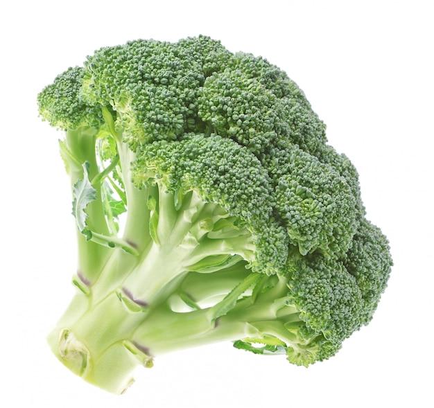 Groenten, verse broccoli op een witte muur. Premium Foto