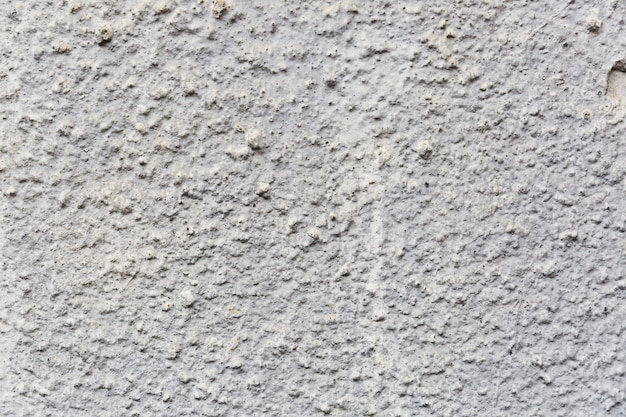 Grof getextureerde cementmuur Gratis Foto
