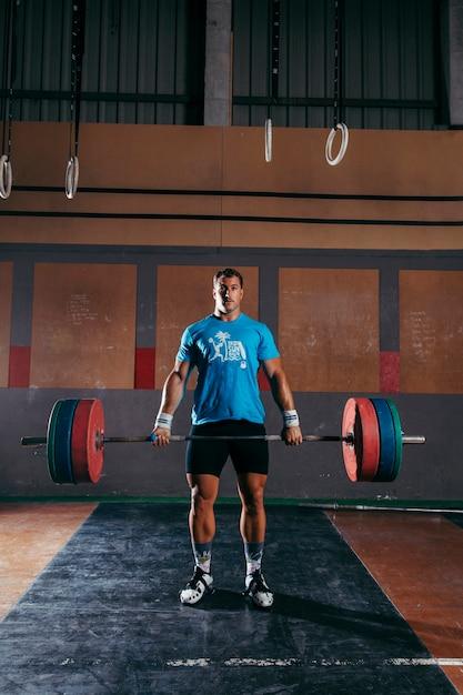 Gymconcept met sterke man Gratis Foto