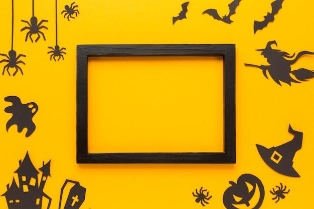 Halloween-feestelementen met mock-upframe Gratis Foto