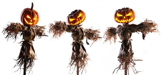 Halloween-pompoenvogelverschrikker op wit wordt geïsoleerd dat Premium Foto
