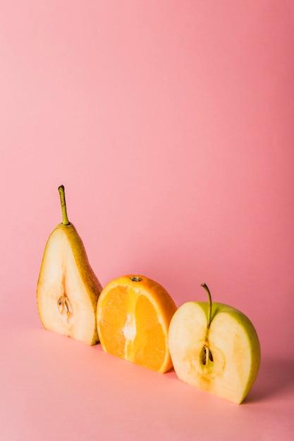 halve peer sinaasappel en appel gratis foto