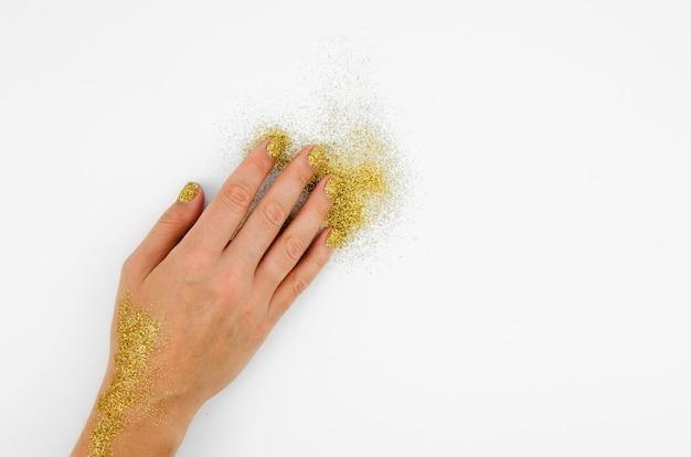 Hand en glitter met kopie ruimte Gratis Foto