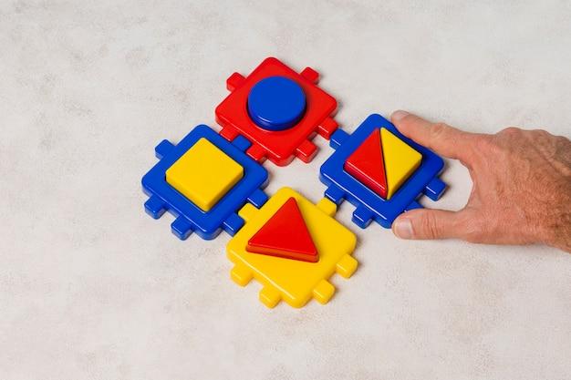 Hand maken puzzel Gratis Foto