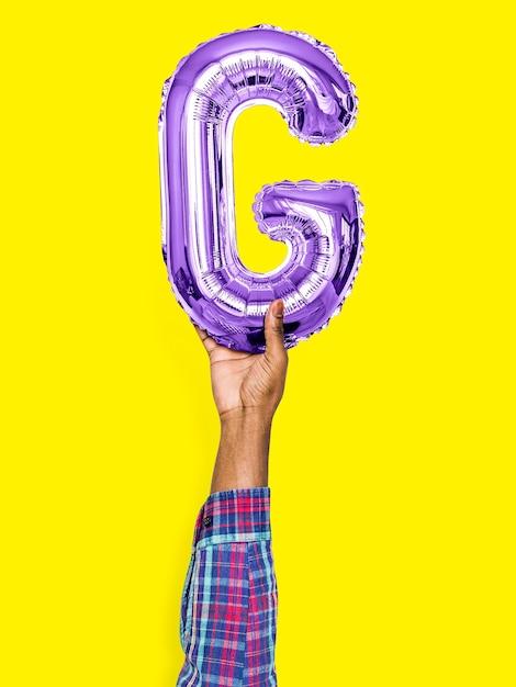 Hand met ballon letter g Gratis Foto