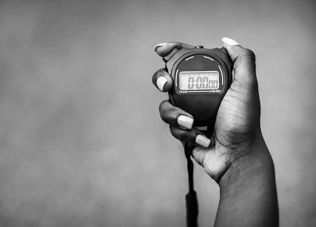 Hand met een stopwatch Gratis Foto