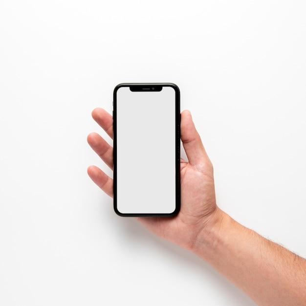 Hand met mobiele telefoon mock-up Gratis Foto