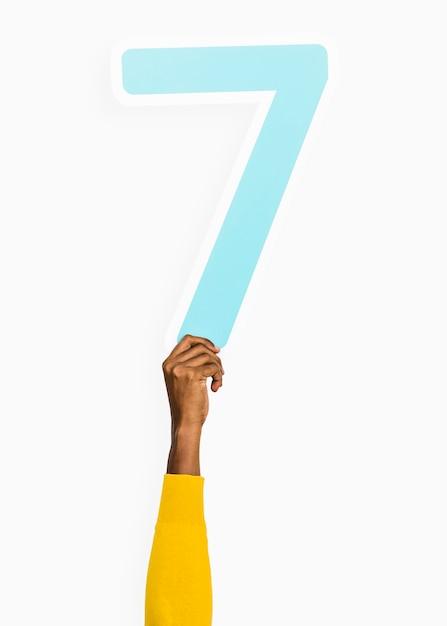 Hand met nummer zeven teken Gratis Foto