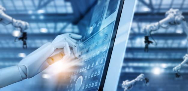 Hand van robot werken op bedieningspaneel in intelligente fabriek industriële monitoring systeemsoftware. Premium Foto