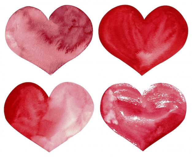 Handgetekende aquarel clipart van rode en roze harten geïsoleerd op de witte achtergrond. Premium Foto