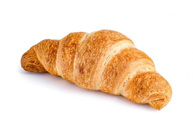 Heerlijke, verse croissant op wit. croissant geïsoleerd. Premium Foto