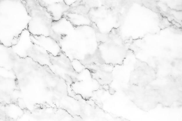 Helder wit natuurlijk marmeren textuurpatroon voor luxueuze achtergrond of huid. Premium Foto
