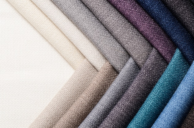Heldere verzameling monsters van jute-textiel. stof textuur achtergrond. Premium Foto