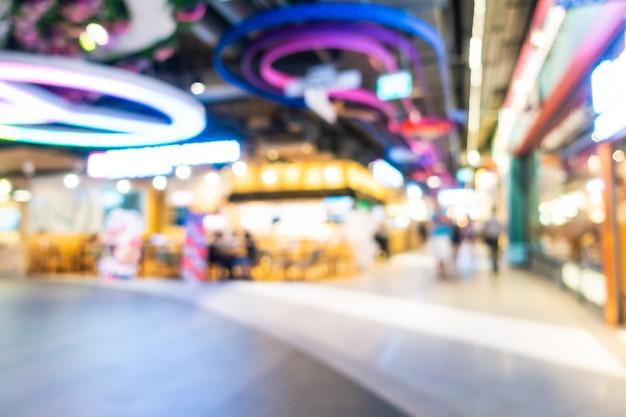 Het abstracte onduidelijke beeld en defocused winkelcomplex en kleinhandelsbinnenland van warenhuis, vage fotoachtergrond Gratis Foto